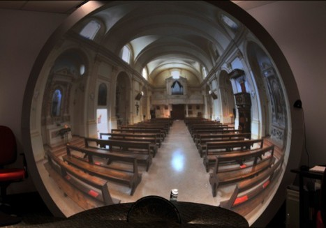The curvature in this image is because the camera is located back from the center of the dome. To the seated viewer all the lines look straight.
