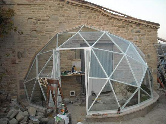 Jan's half GD27 geodesic dome covered in glass and used as a conservatory